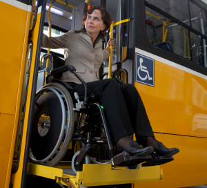 woman in wheelchair getting off bus